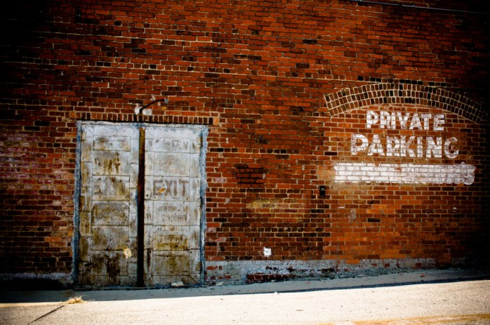 public-domain-images-free-stock-photos-brick-wall-rustic-old-metal-doors-private-parking-1000x664